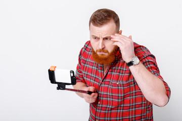 man makes selfie on phone