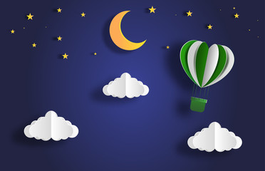 Paper art style of landscape at night with hot air balloon on sky, full moon and stars, flat-style vector illustration.