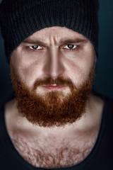 bearded man in hat