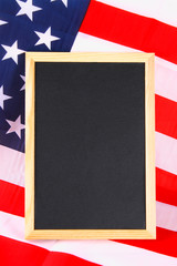 Vintage American flag on a chalkboard with space for text.