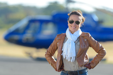young woman by helicopter parking