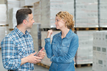 woman and man during warehouse invertory management