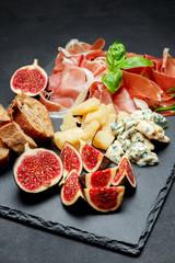 Italian prosciutto crudo or spanish jamon, cheese, figs and bread