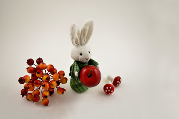 White rabbit toy stock images. Easter bunny on a white background. Autumn still life with a rabbit