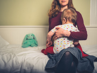 Mother breastfeeding toddler at bedtime