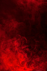 Red smoke or flame texture on a black background. Texture and abstract art