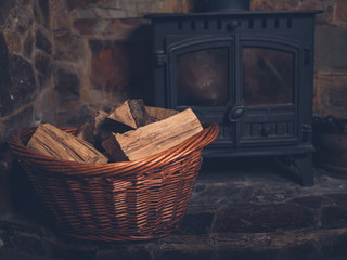 Basket of firewood by log burner