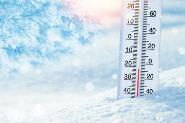 Wintertime. Winter background with  thermometer in the snow on frosty day.