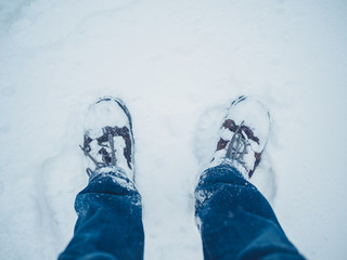 The feet of a man in the snow