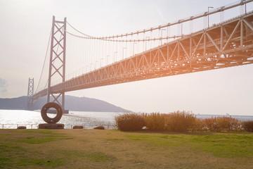 Akashi Suspension bridge over sea coast skyline Kobe Japan
