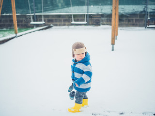 Toddler on a playground in the snow