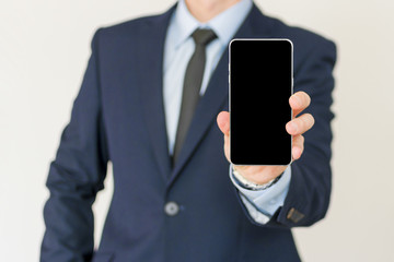 Businessman show his smart phone, smart phone in the hand