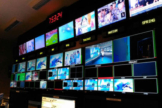 Blurred picture video switch of Television Broadcast, working with video and audio mixer, control broadcasts in recording studio.