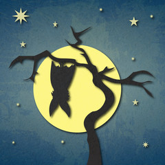 Silhouette bat hanging on a dry tree on background of full moon and starry night.