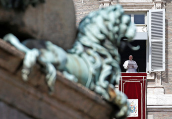 Pope Francis leads the Angelus prayer in Saint Peter's Square at the Vatican
