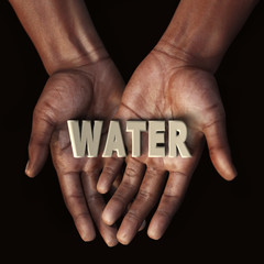African hand with text Water