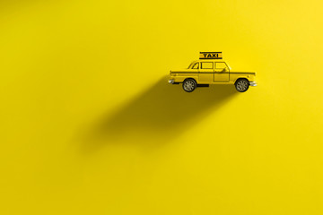 Taxi cab on a yellow background.
