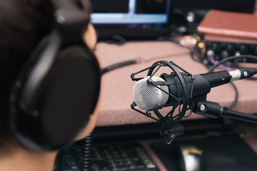 Young woman taking part in broadcast at modern radio station