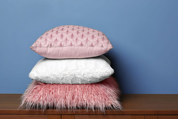 Stack of pillows near color wall