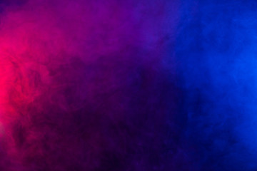 Blue and violet smoke texture on a black background. Texture and abstract art