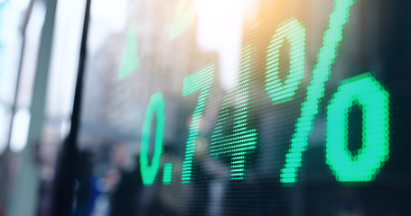 Stock market display showing index in city