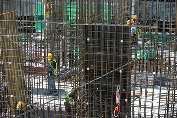 Steel reinforcement bar at the construction site. It uses to strengthen concrete. It is shaped follow the engineering design and tied together using tiny wire.
