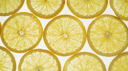 Orange thinly sliced lobules lies on a dark background, juicy, tasty citrus, sweet juice.