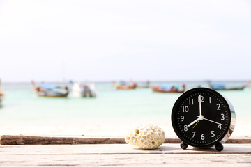 alarm clock On the beach Copy space