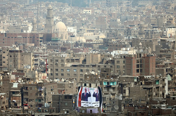 A banner supporting President Abdel Fattah al-Sisi's re-election hangs on a building in downtown Cairo