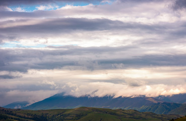 beautiful cloud formations over the mountain ridge. lovely nature background