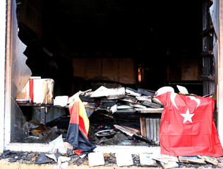 Damaged books are pictured in a mosque after it was destroyed by a fire in Berlin