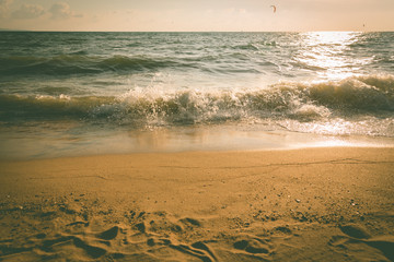 Sea beach with wave in sun set time, vintage toned color photo