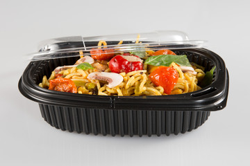 Chinese noodles in takeaway boxes with mushrooms