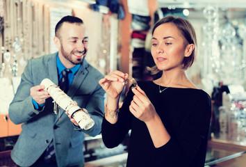 buyer woman choosing bracelet