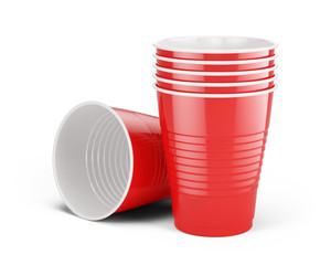 Red disposable cups - plastic cups isolated on white. 3d rendering