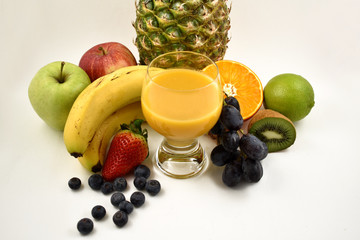 Multivitamin juice stock images. Glass of multivitamin juice with fruits. Multivitamin juice with fruits on a white background. Various fruits images