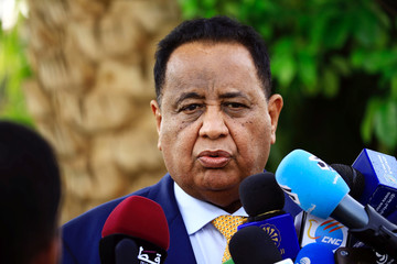 Sudan's Minister of Foreign Affairs Ibrahim Ahmed Abdelaziz Ghandour talks to the press during a joint news conference with Qatar's Minister of Foreign Affairs Mohammed bin Abdulrahman Al Thani in Khartoum