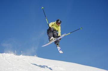 Amazing jump of skier on the mountain slope in beautiful Gudauri, Georgia