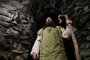 Saint Patrick, played by Marty Burns, poses for a photograph at the re-enactment of the first landing of Saint Patrick in Ireland at Inch Abbey in Downpatrick