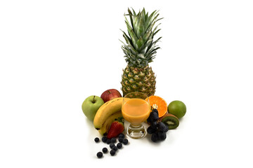 Fresh various fruits stock images. Multivitamin juice images. Glass of multivitamin juice with fruits. Multivitamin juice with fruits on a white background