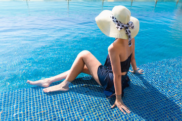Portrait of beautiful woman relaxing in swimming pool, Summer holiday concept