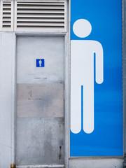 Shiny stainless steel toilet door, abstract