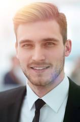 successful businessman on blurred background.