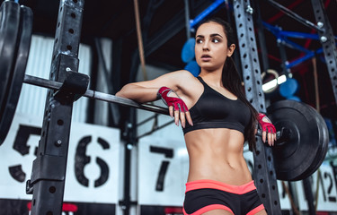 Sporty woman in gym Wall mural