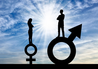 Silhouette of a big man and a small woman standing on gender symbols.