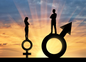 Silhouette of a big man and a small woman standing on gender symbols