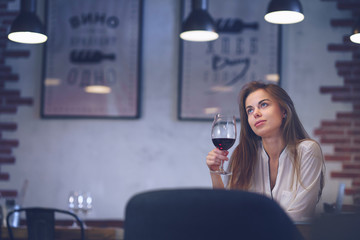 Young attractive girl with a glass of wine