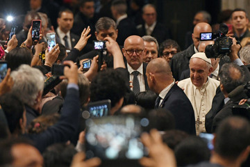Pope Francis arrives for a meeting with the Community of Sant'Egidio, to mark the 50th anniversary of foundation, at Santa Maria in Trastevere basilica in Rome