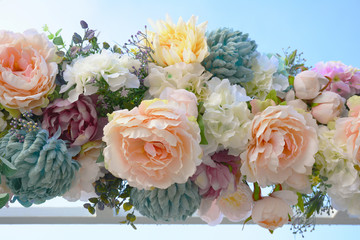 Decorative garland of artificial flowers - roses, hydrangeas and chrysanthemums.