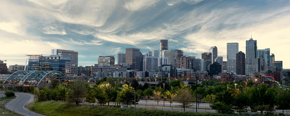 Denver Skyline with morning colors and clouds over the city